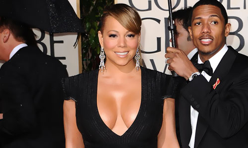 mariah carey's huge breasts are almost showing